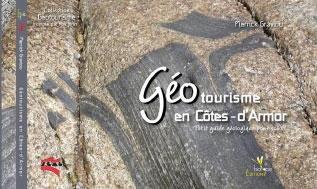 """Photo 6. Collection """"Géotourisme"""" de petits livres qui présentent les géosites par département. Ici les Côtes-d'Armor (Graviou, 2012)"""